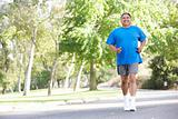 Senior Man Jogging In Park