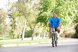 Senior Man Cycling In Park