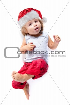 Cute little Santa helper in red pants, high angle view