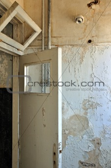 door frame and peeling paint wall