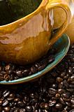 Detail of a coffee mug with coffee beans