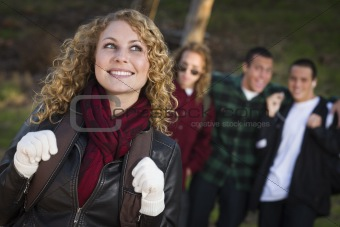 Pretty Young Teen Girl with Three Boys Behind Admiring Her.