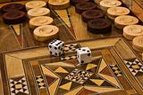 2 dice on the backgammon desk