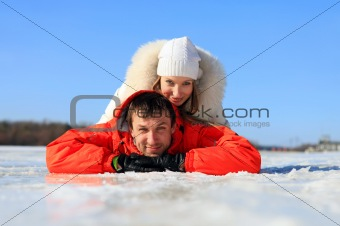 Portrait of young couple having fun on frozen river