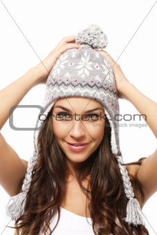 sweet young brunette woman wearing winter cap