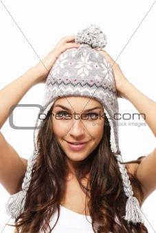 sweet young brunette woman wearing winter cap