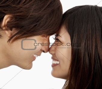 asian couple face to face and isolated on white