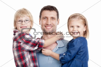 father with his two children looking at the camera, smiling - isolated on white