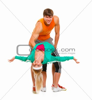 Fit young female and guy in sportswear having fun isolated on white