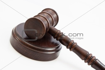 folded down lwooden judge gavel and stand