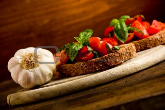 Bruschetta appetizer with fresh tomatoes