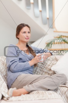 Portrait of a calm woman holding a cup of tea