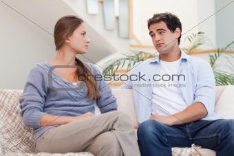 Young couple having an argument while watching TV