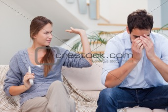 Man being tired of arguing with his wife