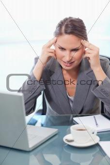 Portrait of an upset businesswoman having a headache