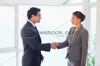 Side view of trades partner closing deal