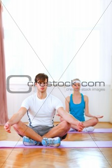 Healthy couple at yoga class