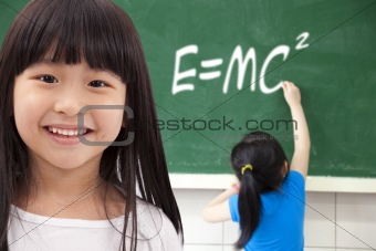 happy girls  by chalkboard with e=mc2