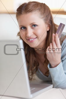 Close up of female online shopper on her sofa