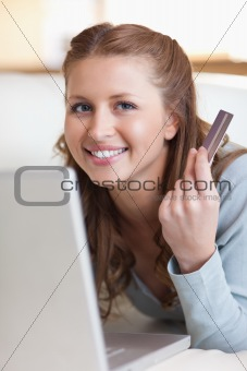 Close up of smiling female booking a flight online