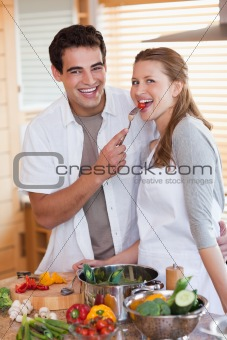 Couple enjoys preparing lunch together