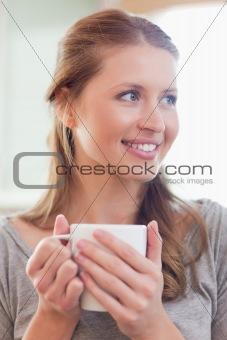 Close up of smiling woman with a cup of tea