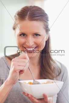 Close up of woman eating cereals