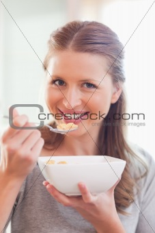 Close up of smiling woman having breakfast