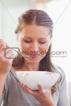 Close up of female eating cereals