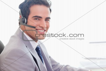 Side view of smiling businessman with headset on