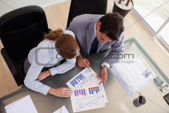 Above view of consultant analyzing data with her client