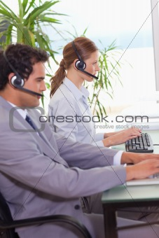 Call center agents working next to each other