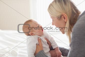 Affectionate mom holding her newborn