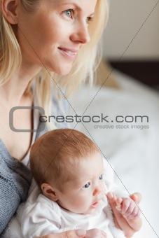 Mother hugging her newborn