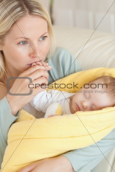 Close up of provident mother kissing her baby's hand