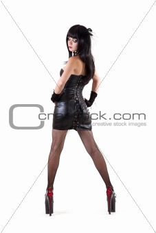Dominant woman dressed wearing extremely high heels
