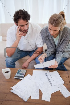 Portrait of a worried young couple doing their accounting