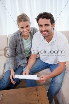 Portrait of a happy couple reading a letter