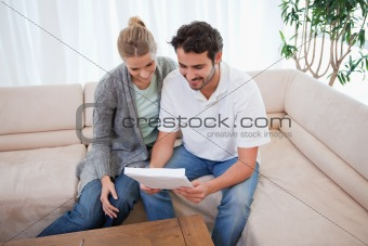 Couple reading a letter