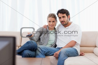 Lovely couple watching TV