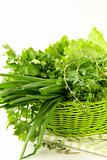 fresh green grass parsley dill onion herbs mix in a wicker basket