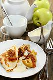 Pancakes with baked apples and vanilla sauce.