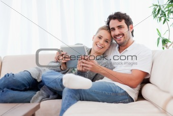 Happy young couple using a tablet computer