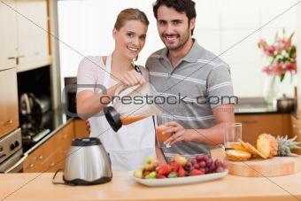 Couple drinking fruits juice