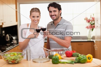 Couple drinking a glass of red wine