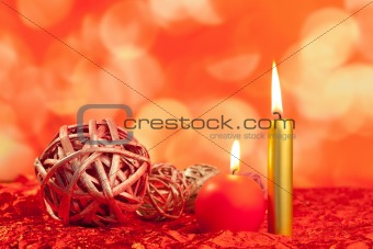 christmas candles with dried baubles on red
