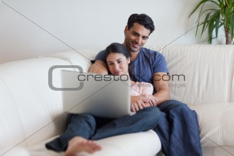 Couple watching a movie while eating popcorn