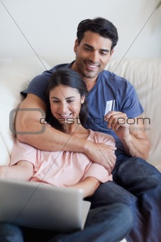 Portrait of a couple booking their holidays online