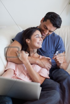Portrait of a lovely couple booking their holidays online
