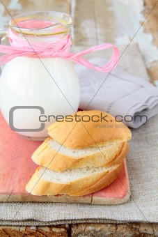 fresh bread and a jug of milk - a rustic still life